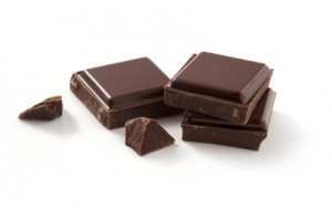 A few pieces of chocolate isolated on white background. Cleaned and retouched photo. Clipping path included.